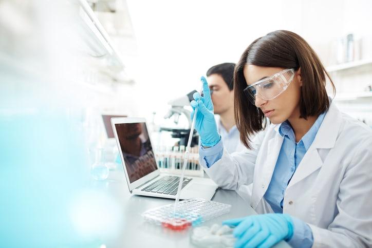 scientist using pipette laboratory