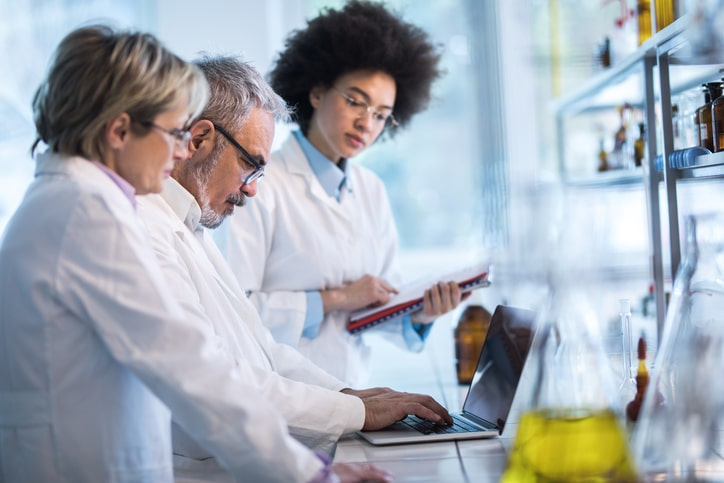 scientists in laboratory doing analysis