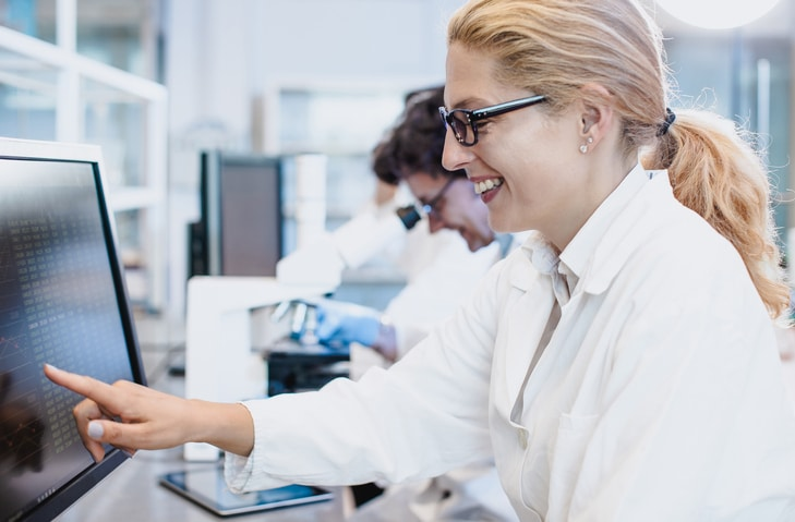 scientist working on computer
