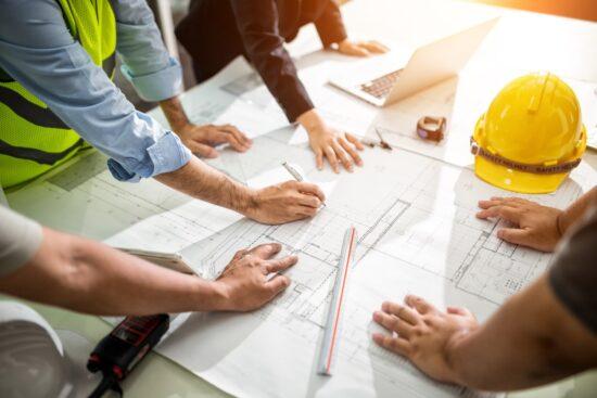 engineers looking at blueprints