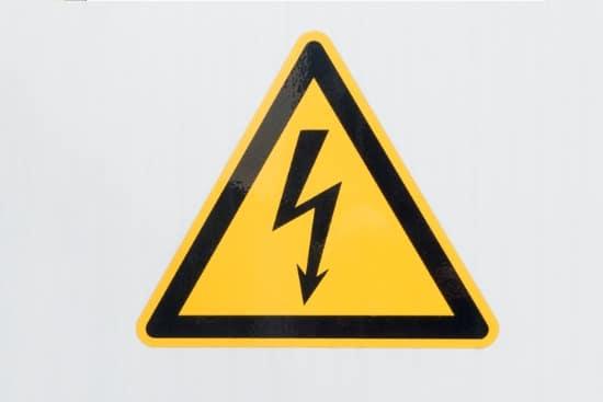 high voltage sign on grey background